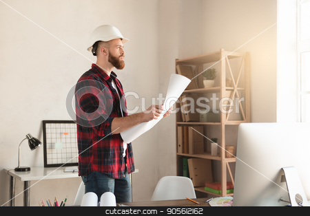 Young man architect working in the office ocuupation stock photo, Young male architect working indoors draft blueprint by Dmytro Sidelnikov