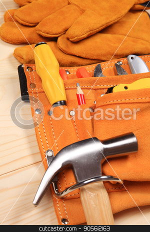 Set of working tools on wooden background stock photo, Hammer, pliers, red pencil, work gloves and other tools isolated on a wooden background by bvb1981