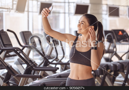 Young woman workout in gym healthy lifestyle stock photo, Young female training in gym healthy lifestyle taking photos by Dmytro Sidelnikov