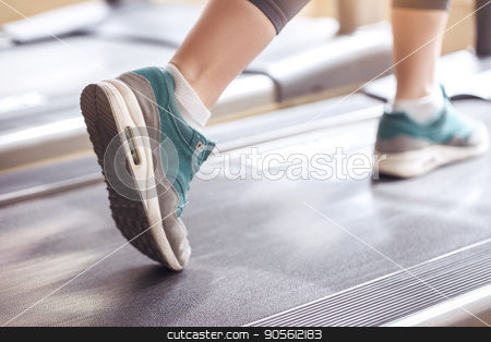 Young woman workout in gym healthy lifestyle stock photo, Young female training in gym healthy lifestyle treadmill by Dmytro Sidelnikov
