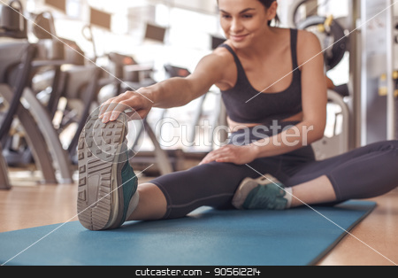 Young woman workout in gym healthy lifestyle stock photo, Young female training in gym healthy lifestyle exercise on yoga mat by Dmytro Sidelnikov