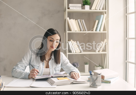 Young woman study at home alone education stock photo, Young woman study at home alone reading a book by Dmytro Sidelnikov