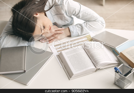 Young woman study at home alone education stock photo, Young woman study at home alone sleeping by Dmytro Sidelnikov