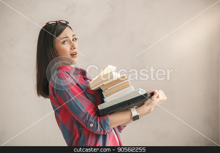 Young woman with books studio portrait education stock photo, Young female carry books isolated on white by Dmytro Sidelnikov