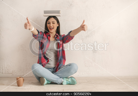 Young woman with a book studio portrait stock photo, Young female with a book isolated on white balance by Dmytro Sidelnikov