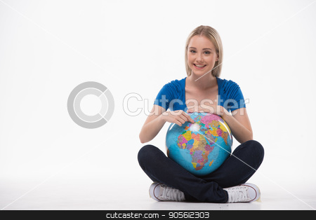 Beautiful young woman on white background stock photo, Travel concept. Portrait of stylish beautiful young woman isolated on white background. Woman smiling, looking at camera, sitting and holding globe by Dmytro Sidelnikov