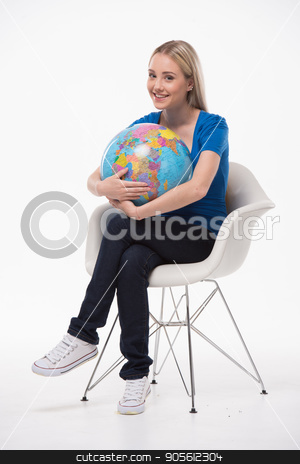 Beautiful young woman on white background stock photo, Travel concept. Portrait of stylish beautiful young woman isolated on white background. Woman smiling, looking at camera, sitting and holding globe. Free space for logo by Dmytro Sidelnikov