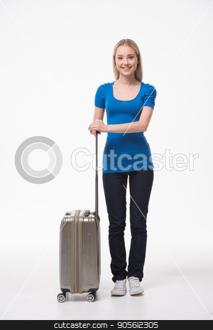 Beautiful young woman on white background stock photo, Travel concept. Portrait of stylish beautiful young woman isolated on white background. Woman with suitcase smiling, looking at camera by Dmytro Sidelnikov