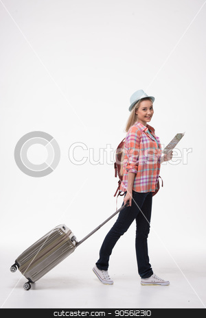 Beautiful young woman on white background stock photo, Travel concept. Portrait of stylish beautiful young woman isolated on white background. Woman with suitcase and backpack smiling and using map by Dmytro Sidelnikov
