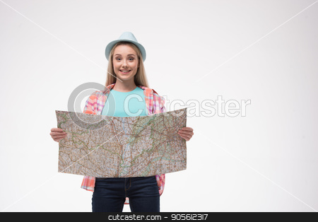 Beautiful young woman on white background stock photo, Travel concept. Portrait of stylish beautiful young woman isolated on white background. Woman smiling and using map. Free space for logo by Dmytro Sidelnikov