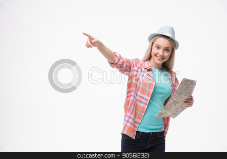 Beautiful young woman on white background stock photo, Travel concept. Portrait of stylish beautiful young woman isolated on white background. Woman smiling, pointing aside and holding map. Free space for logo by Dmytro Sidelnikov