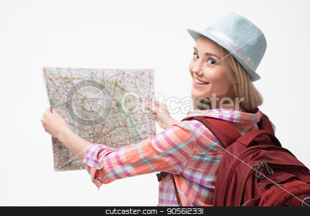 Beautiful young woman on white background stock photo, Travel concept. Back view photo of stylish beautiful young woman isolated on white background. Woman with backpack smiling and using map by Dmytro Sidelnikov