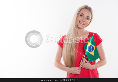 Beautiful young woman on white background stock photo, Travel concept. Portrait of stylish beautiful young woman isolated on white background. Woman smiling, looking at camera and holding Flag of Brazil by Dmytro Sidelnikov