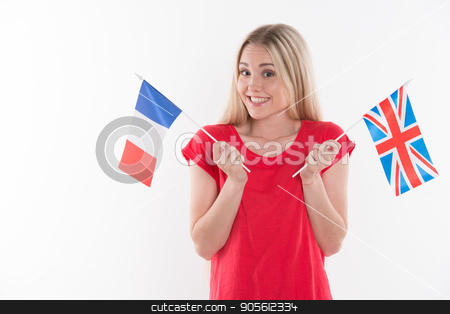 Beautiful young woman on white background stock photo, Travel concept. Portrait of stylish beautiful young woman isolated on white background. Woman smiling, looking at camera and holding flags of France and England by Dmytro Sidelnikov
