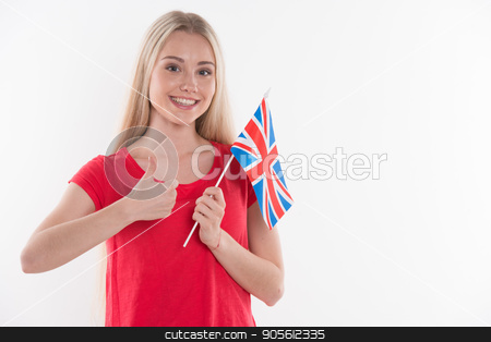 Beautiful young woman on white background stock photo, Travel concept. Portrait of stylish beautiful young woman isolated on white background. Woman smiling, looking at camera and holding flag of England by Dmytro Sidelnikov