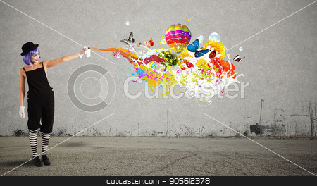 Woman clown with colored spray stock photo, Woman clown with colored spray paints trails by Federico Caputo