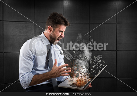 Stress and frustration caused by a computer stock photo, Stress and frustration of a businessman caused by a computer by Federico Caputo
