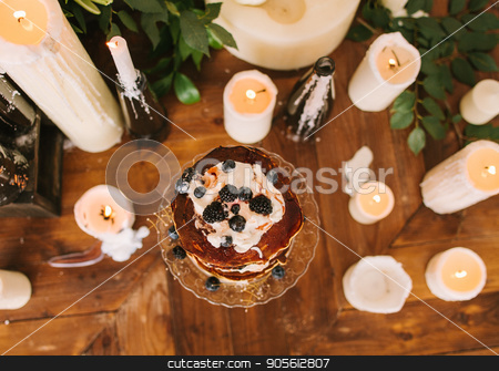cake from pancakes with whipped cream and blueberry. stock photo, Cake top from pancakes with whipped cream and fresh blueberry, lit candles of the different sizes on old wooden background, top view. date, engagement, romantic, event concept. Fine art Wedding decor. by Dmitry