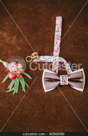 groom's accessories for a wedding. stock photo, groom's accessories for a wedding. top view on a bow tie, buttonhole and rings on a brown velvet background. preparation for a wedding. set groom concept. by Dmitry