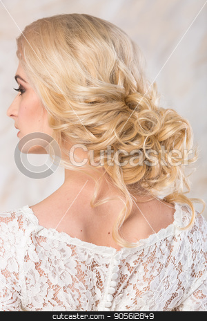 fashionable gown, beautiful blonde model, bride hairstyle and makeup concept - back view on young charming lady in wedding white dress standing indoors on light background, pretty woman posing. stock photo, fashionable gown, beautiful blonde model, bride hairstyle and makeup concept - back view on young charming lady in wedding white dress standing indoors on light background, pretty woman posing by Dmitry