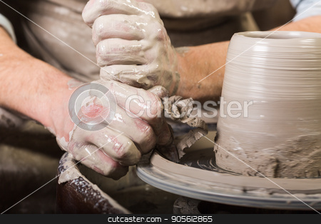 pottery, workshop, ceramics art concept - male hands work with potter's wheel, fingers form shape of raw clay, male master sculpt a utensil with carving tool, front view. stock photo, pottery, workshop, ceramics art concept - male hands work with potter's wheel, fingers form shape of raw clay, male master sculpt a utensil with carving tool, front view by Dmitry