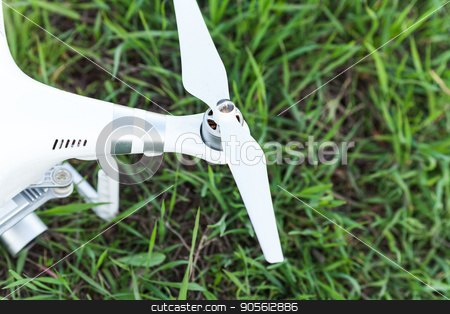 quadcopter outdoors, aerial imagery and tech hobby, recreation concept - rotor of white quadrocopter before flight on summer lawn with green grass, closeup white drone propeller, fuselage and camera. stock photo, quadcopter outdoors, aerial imagery and tech hobby, recreation concept - rotor of white quadrocopter before flight on summer lawn with green grass, closeup white drone propeller, fuselage and camera by Dmitry