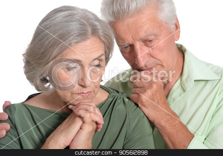 sad senior couple stock photo, Portrait of sad senior couple isolated on white background by Ruslan Huzau