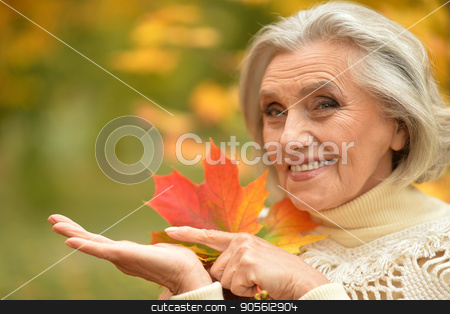 beautiful senior woman stock photo, Portrait of a beautiful senior woman outdoors by Ruslan Huzau