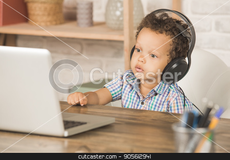 Little Boy Using Digital Device Modern Technology stock photo, Little boy sitting using laptop modern technology by Dmytro Sidelnikov