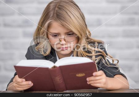 Little Girl Study Learning Education Knowledge Concept stock photo, Little girl study school homework smart student by Dmytro Sidelnikov