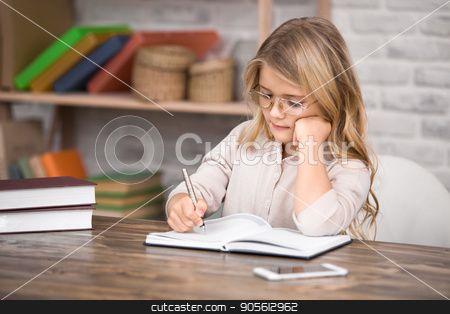 Little Girl Study Learning Education Knowledge Concept stock photo, Little girl study school homework smart student by Dmytro Sidelnikov
