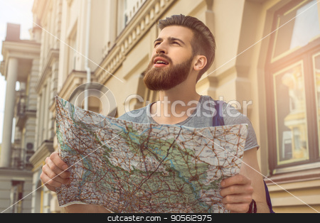 Young man city walk travel vacation lifestyle stock photo, Young man city walk travel vacation lifestyle holding map by Dmytro Sidelnikov
