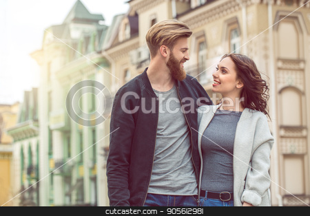 Young couple tourists city walk together vacation stock photo, Young couple woman and man tourists city walk together vacation hugging by Dmytro Sidelnikov