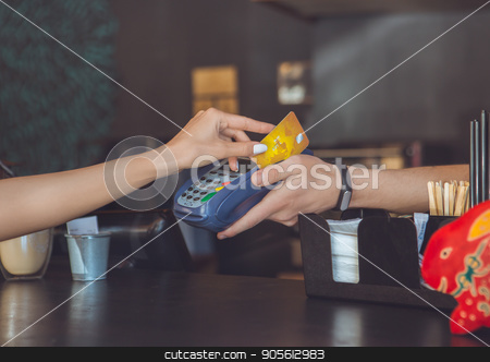 Young woman sitting in a coffee shop leisure stock photo, Young female sitting in a cafe indoors rest cashless payment by Dmytro Sidelnikov