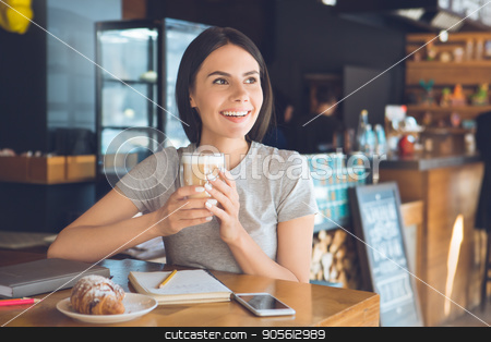 Young woman sitting in a coffee shop leisure stock photo, Young female sitting in a cafe indoors rest drinking coffee by Dmytro Sidelnikov