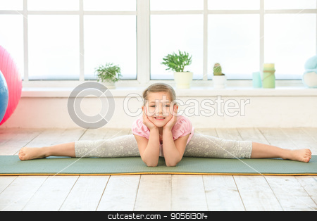 Little kid girl exercise in the morning indoors stock photo, Little child girl exercise in the morning indoors by Dmytro Sidelnikov