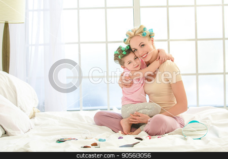 Young mother and daughter morning on bed indoors stock photo, Young mother and daughter morning on bed at home makeup by Dmytro Sidelnikov