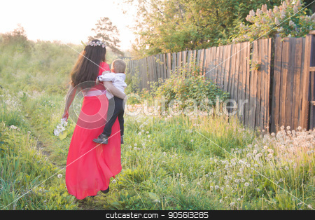 Concept of the severity of motherhood stock photo, Concept of the severity of motherhood. Mother carries her son in her arms. Photo for your design by Kseniia