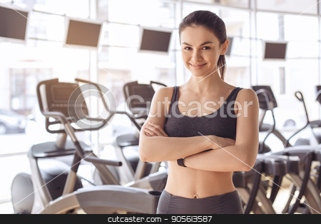 Young woman workout in gym healthy lifestyle stock photo, Young female training in gym healthy lifestyle smiling by Dmytro Sidelnikov