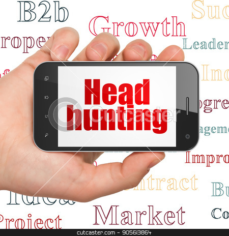 Business concept: Hand Holding Smartphone with Head Hunting on display stock photo, Business concept: Hand Holding Smartphone with  red text Head Hunting on display,  Tag Cloud background, 3D rendering by mkabakov