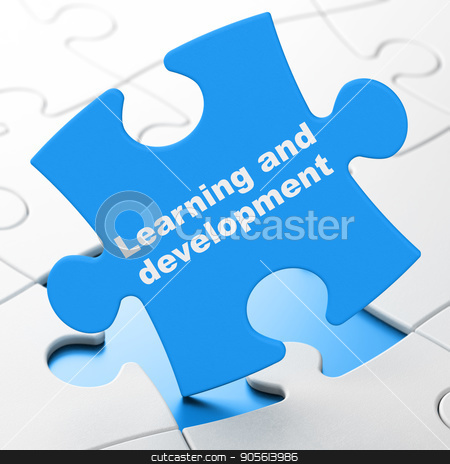 Education concept: Learning And Development on puzzle background stock photo, Education concept: Learning And Development on Blue puzzle pieces background, 3D rendering by mkabakov