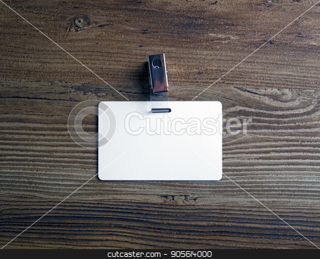 Blank white badge stock photo, Photo of blank white plastic badge on vintage wooden table background. Blank id card. Top view. by Veresovich