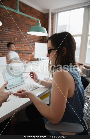 Executives discussing over laptop stock photo, Executives discussing over laptop in office by Wavebreak Media