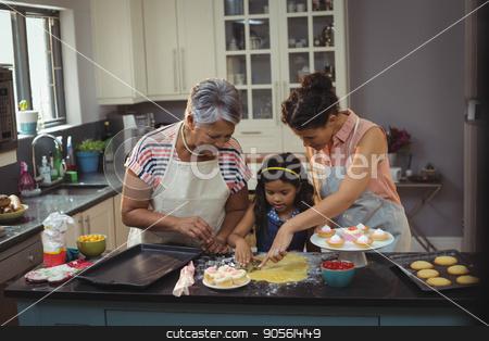 Happy family preparing desserts in kitchen stock photo, Happy family preparing desserts in kitchen at home by Wavebreak Media