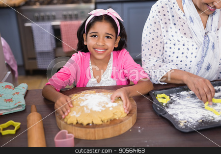 Portrait of smiling girl preparing food in kitchen stock photo, Portrait of smiling girl preparing food in kitchen at home by Wavebreak Media