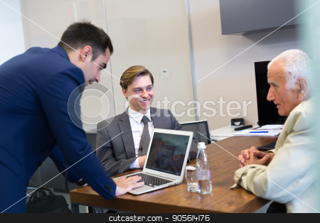 Business people sitting and brainstorming at corporate meeting. stock photo, Business people sitting and brainstorming at corporate meeting. Team work and business success concept. by kasto