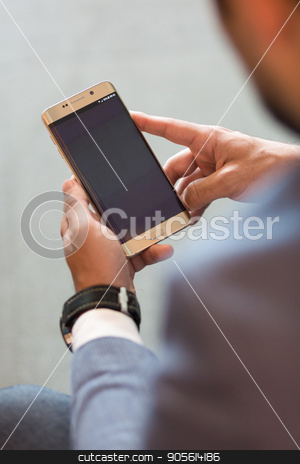 Close up of businessman using mobile smart phone. stock photo, Close up of a businessman using smart phone. Focus on mobile device. Copy space. by kasto