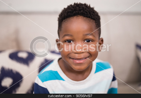 Portrait of smiling boy at home stock photo, Close up portrait of smiling boy at home by Wavebreak Media