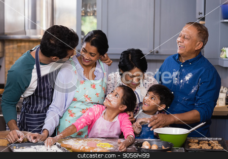 Happy multi-generation family enjoying in kitchen stock photo, Happy multi-generation family enjoying while preparing food in kitchen at home by Wavebreak Media