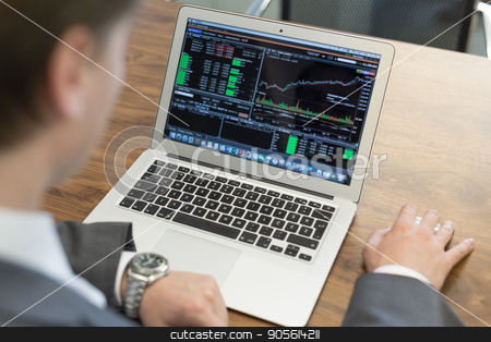 Young businessman working with laptop, man's hands on notebook computer. stock photo, Corporate businessman analyzing economic data on laptop computer. Man's hands on notebook computer, business person at workplace. by kasto